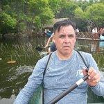 Canoeing across the lagoon to zipline & cenote