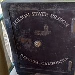 Old safe displayed on the porch.