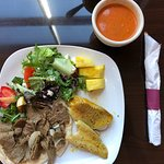 Dinner plate with soup, salad, lamb and fish