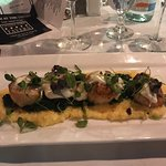 Scallops over risotto. Beautiful presentation, flavors and quality