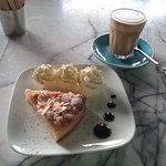 Latte with almond and pear tart