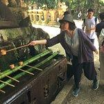 Reiko-san demonstrating purification to enter the shrine.