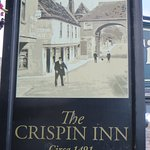 Inn sign board showing picture Barbican bridge and front of Inn. No traffic in those days.