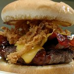 Western burger with BBQ, bacon, cheese and onion straws