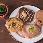 Chocolate peanut butter, cappuccino, matcha, and granola donuts