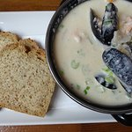 Seafood Chowder filled smoked salmon, shrimp, cod, and mussels in a creamy white sauce.
