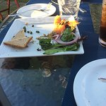 Outdoor table and salmon appetizer