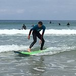 learning to surf with Fistral beach surf school
