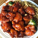 Asian Boy General Tso chicken with Lo Mein Noodle Lunch Combo