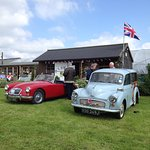 Vintage car and classic cars in front of the tearoom.