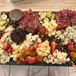 We specialize in custom cheese and charcuterie boards.  This one's for a large group who had a p