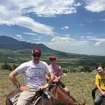 me and my son in the yellow shirt horseback riding