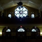 Rose stained glass behind choir loft