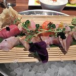 sashimi dinner - pieces dotted with roes. Ordinary.. Would be better if fish was sliced thicker.