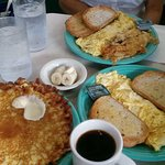 Crepe-style hotcakes, omelet, coffee, potatoes, bananas, and toast!
