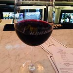 We sat at the bar. There is a wall behind the bar with a large number of wine bottles along the