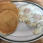 Sunny side eggs with pancakes