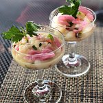 The perfect summer starter our scallop ceviche with cilantro, jalapeño, and red onion