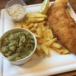 Standard size Gluten free haddock and chips with mushy peas and tartar sauce.