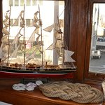 Model ship, ship's mat in the guest lounge.