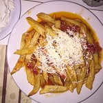 Fried hand cut potatoes with tomato sauce and cheese - yummy-