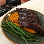 Ribs, green beans, yellow rice and carrot