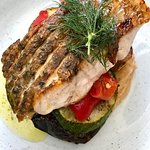 Salmon on a Mediterranean veggie stack