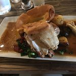 Roast Pork Loin with Stuffing wrapped in bacon & crackling