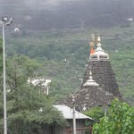 Trimbakeshwar Temple and Brahmagiri hill in background.
