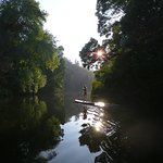 Stand up paddle at sunset in the Paiva river, a small tributary of the Douro