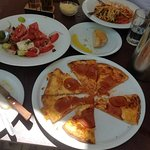 Delicious pepperoni pizza,  fresh and tasty Greek salad, complimentary bread to die for, amazing