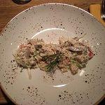 Салат из трех видов мяса (тарелка не перцем посыпана, это дизайн тарелки). Кстати, вкусный