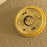 A broken smoke detector did not seem to be a serious concern for the motel staff/