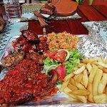 Platter for Two: Jollof rice, chips, tbone, chicken wings, crocodile ribs & bites, roasted vegs