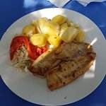 Pan fried tilapia with mashed potato and salad - at Goretties Restaurant