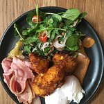Corn fritters with bacon and poached eggs
