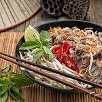 Reisnudeln mit Rindfleisch und Sauce/Rice noodles with beef and gravy/Pho kho