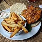 The Smokey Joe, beef burger topped with Applewood cheese, bacon, crispy onion bits & a smoky sau