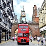 London Routemaster Sightseeing bus Chester, under the beautiful Eastgate Clock