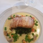 Hake paired with the house wine was gorgeous. The wine list was also very impressive .