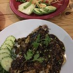 Red snapper in a thick black pepper sauce