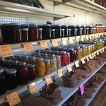 Canned goods in an Amish store, buggy and farm in the fall.