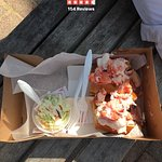 Lobster roll with mayo and cole slaw (can substitute slaw for chips)