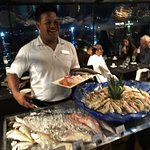 """The man himself """"Akash"""" showing the fish available."""