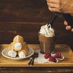 Ice Belgian chocolate with homemade whipped cream, cream-horns and raspberries pralines