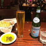 FIrst course - sliced bread, olive oil and spices, Peroni beer and San Pellegrino sparking water