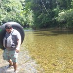 Sergio carrying the weight of the world as we head out through the pretty jungle to the tubing s