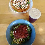 Top photo is the bison taco and bottom is posu bowl with chicken. Local beer to round out the me