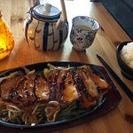 Teriyaki chicken with sticky rice and green tea to drink