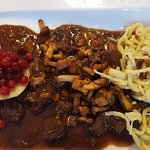 Ragout of local venison, spätzle, lingonberries on roasted apple